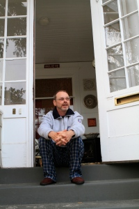 Jeff Neal sits on the front stoop of his house on the 300 block of San Rafael St. Neal was surprised by how much the previous owner of his house didn't tell him about the CC partying in the neighborhood.